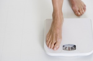 Woman Stepping onto Scale